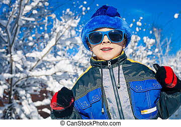 Happy little boy playing on winter snow day. - Cute little...