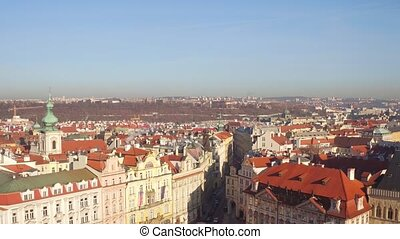 Sloped roofs and gothic spires of old town of Prague on a...