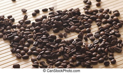 Many coffee roasted beans falling down. Slowly.