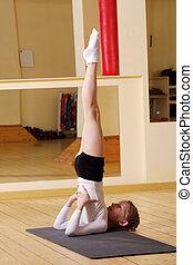 Little gymnast stretching legs up - Little gymnast girl...