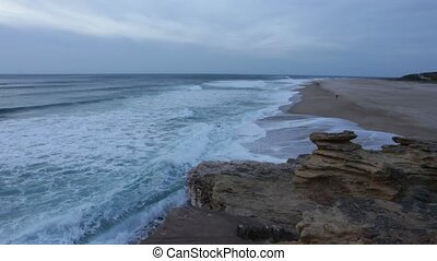 After sunset, the waves on the beach in Nazare. Portugal