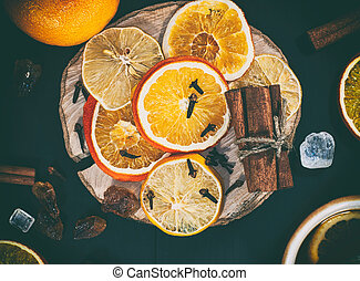 slices of citrus fruits on a wooden surface