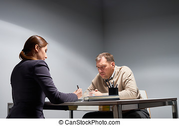 Female Boss Giving Reprimand - Unkempt middle-aged man...