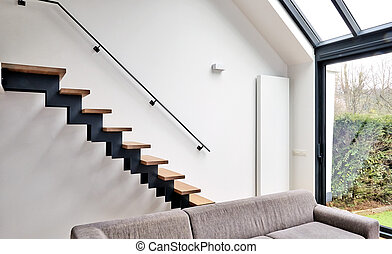 Hardwood stairs in modern renovated living room
