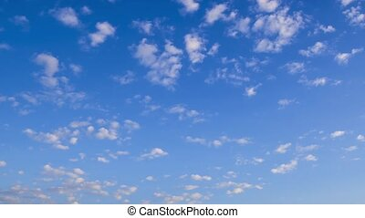 Timelapse movie of morning sky with white spindrift clouds...