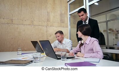 Angry male manager talking with employees - Angry young...