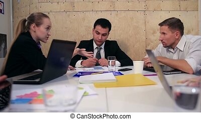 Business people brainstorming on meeting at office - Five...