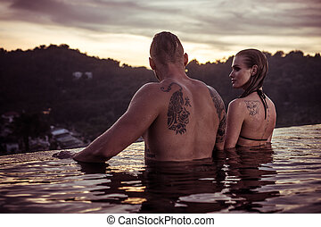 Romantic couple alone in infinity swimming pool - Romantic...