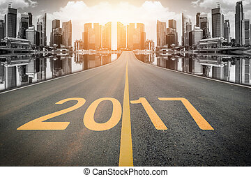 2017 figures on the steet with the skyscraper background for...