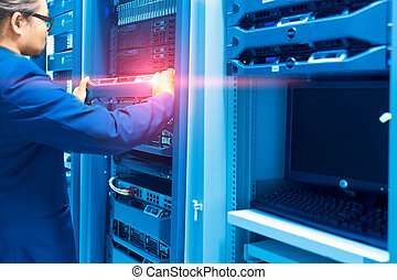 Man fix server network in data center room