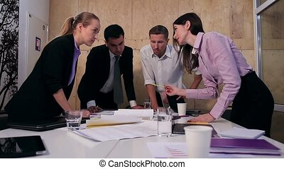 Bussiness people analyzing project at meeting - Four...