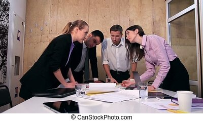Creative business team working on project at office -...