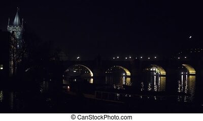 Famous Charles bridge and distant Prague castle at night,...