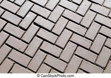 Dark gray brick pavers. Background.