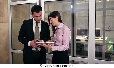Business people working on touchpad - Attractive...