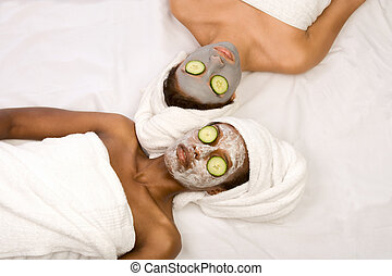 Beauty treatment spa - Two girls are relaxing during facial...