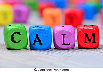 Calm word on table - Calm word on wooden table