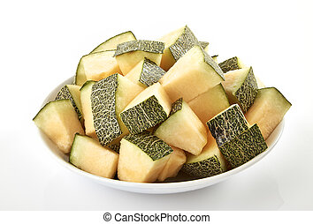 Melon slices stack - Melon slices in plate on white...