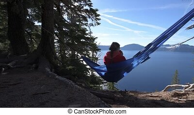 Women Relaxing in Hammock Crater Lake Oregon - Woman Hiker...