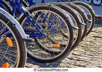 bicycle wheels - Detail of the wheels of many blue bicycles...