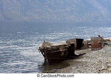 Old fishing vessel on the lake coast