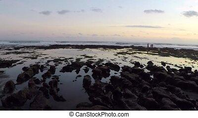 Ocean stony coastline at picturesque sunset