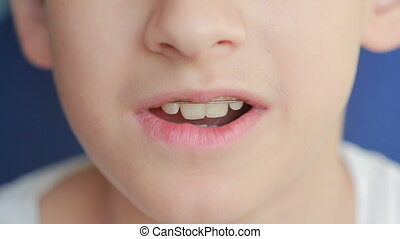 smiling child with braces on teeth - smile with braces on...