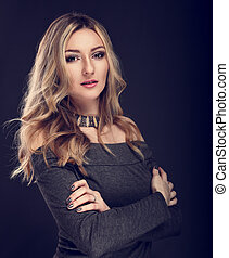 Fashion success business blond woman with folded arms...