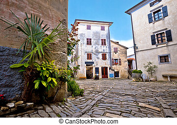 Old cobbled square of Groznjan village, region of Istria,...