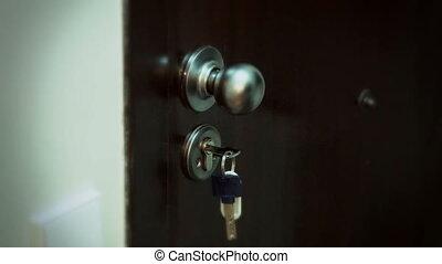Men's hand opens the door - Men's hand opening door with a...