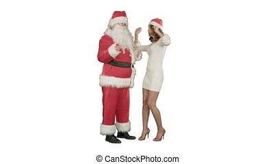 Christmas woman with santa claus dancing on white background