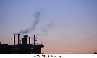 smoke from the chimneys of town houses on a background of...