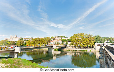 Between two bridges at Beziers view across Orb River to city...