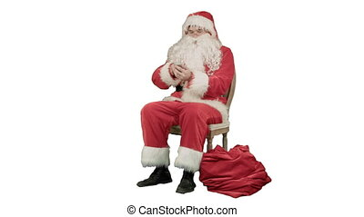 Santa claus calling by mobile cell phone on white background