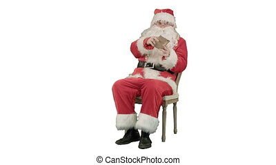 Santa Claus sitting on chair with letters in hands on white background