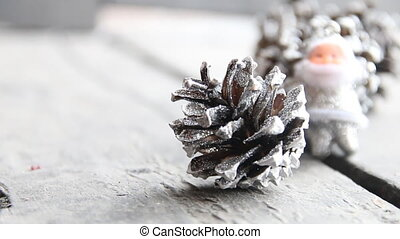 Christmas decorations with snow covered pinecones