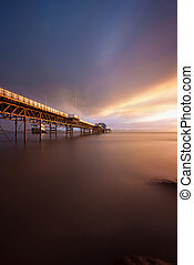 Daybreak at Mumbles pier - Sunrise at Mumbles Pier showing...