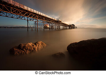 Morning at Mumbles pier - Sunrise at Mumbles Pier showing...
