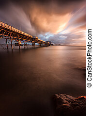 Mumbles pier sunrise - Sunrise at Mumbles Pier showing the...