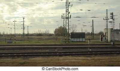 Train journey window view - Train leaving an industrial...