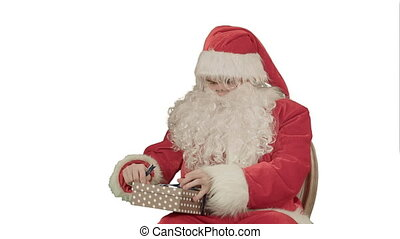Santa Claus: Cheerful Gifts on white background....