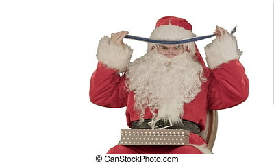 Santa Claus holding Christmas gifts on white background....
