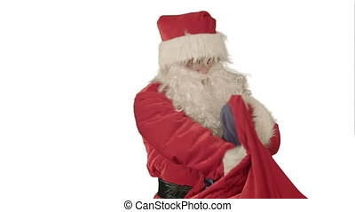 Real Santa Claus carrying presents in his sack on white background