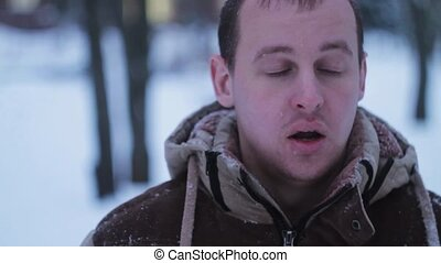 man was out of breath in the winter on the street - the...