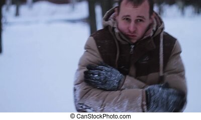 man basks in the winter against snow