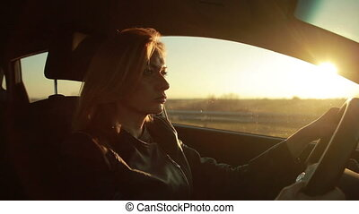 Blondie young woman driving a car - young woman leads a car...