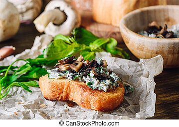 Bruschetta with Fried Agaricus and Sour Cream on Paper