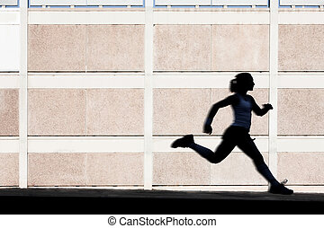 Physically fit woman runs for exercise - Woman in the...