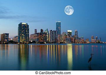 Moon rising over Miami, Florida