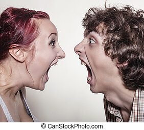Young couple arguing - Close-up portrait of a pair of angry...